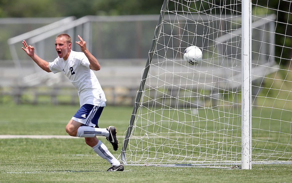Iowa City Regina's Johhny Rummelhart celebrates his hat trick, scoring his third goal in the Regals' in a 3-0 win over Fort Madison Holy Trinity Catholic in the state soccer tournament on June 3. (Christopher Gannon/The Register)
