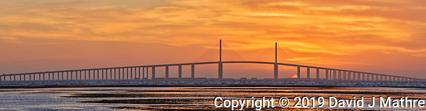 Sun rising under the Sunshine Skyway bridge from Fort De Soto Park. Composite of 9 images taken with a Fuji X-H1 camera and 200 mm f/2 OIS lens with a 1.4x teleconverter (ISO 400, 280 mm, f/16, 1/80 sec). Raw images processed with Capture One Pro and AutoPano Giga Pro. (DAVID J MATHRE)