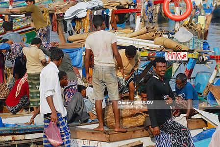 AL HUDAYDAH, YEMEN - SEPTEMBER 17, 2006: Unidentified fishermen unload catch of the day from fishing boats in the port in Al Hudaydah, Yemen. (Dmitry Chulov)