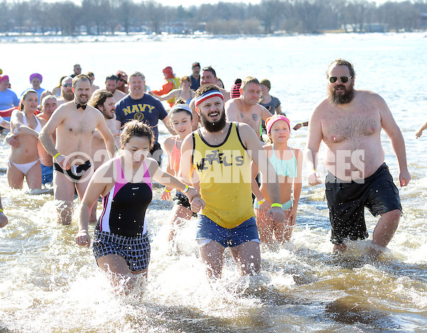 A group of plungers exit the 32 degree Delaware River during the eighth annual Eastern Polar Bear Plunge to benefit Special Olympics Pennsylvania (SOPA) Saturday January 30, 2016 at Neshaminy State Park in Bensalem, Pennsylvania. (Photo by William Thomas Cain) (William Thomas Cain/Cain Images)