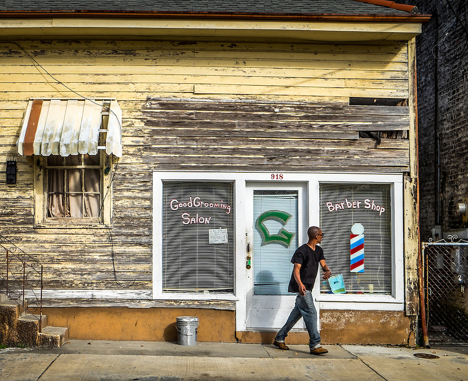 NEW ORLEANS - CIRCA FEBRUARY 2014: Man walks out of a baber shop in McDonough, a popular community within the city of New Orleans in Louisiana. (Daniel Korzeniewski)