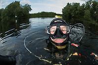A pool Frog (Pelophylax lessonae) join underwater photographer Magnus Lundgren, Crisan, Danube Delta, Romania. (Magnus Lundgren / Wild Wonders of Europe)
