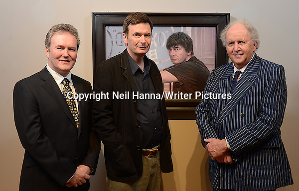 Ian Rankin & his portrait gifted to Scottish National Portrait Gallery by Alexander McCall Smith L-R Guy Kinder (artist), Ian Rankin and Alexander McCall Smith 18th February 2013 Photograph by Neil Hanna/Writer Pictures WORLD RIGHTS (Must Credit: Neil Hanna/Writer Pictures)