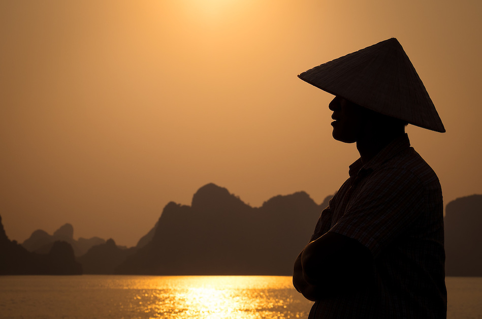 HA LONG BAY, VIETNAM - CIRCA SEPTEMBER 2014:  Profile of Vietnamese man in Halong Bay (Daniel Korzeniewski)