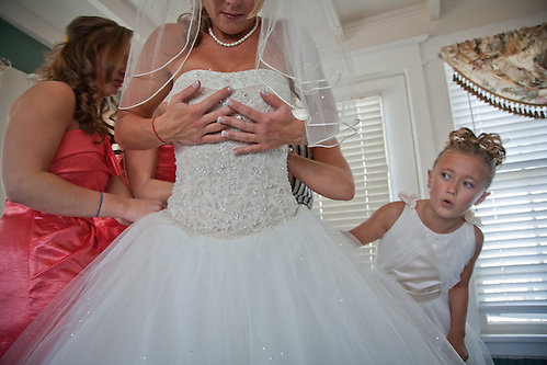 Alyana wonders with the bride will fit in her dress. (Clark James Mishler)