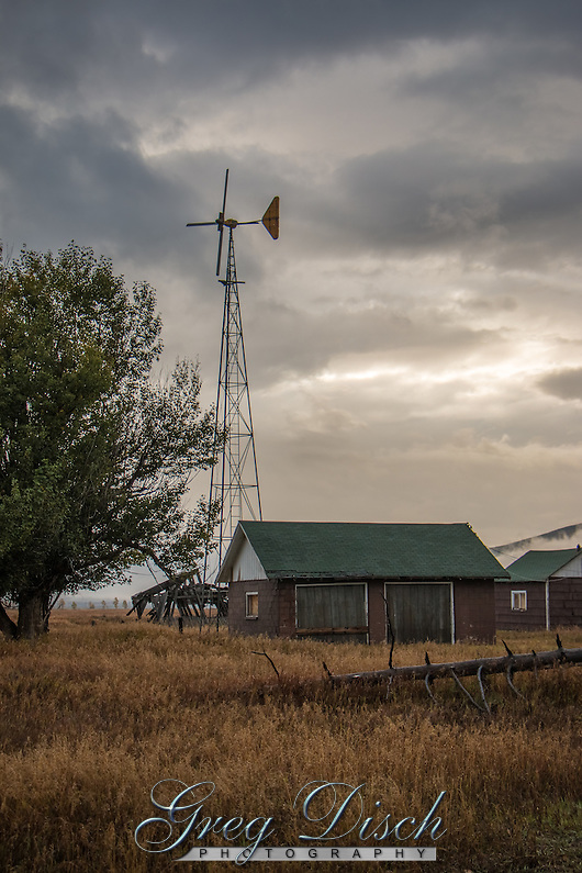 The most extensive historic complex remaining on Mormon Row is the Andy Chambers homestead. Andy Chambers claimed land in 1912 and secured the title under the Homestead Act by building a log cabin and stable and clearing ground to grow grain, a backbreaking chore in the rocky soil. The family lacked running water until 1927 and harnessed electricity with a windmill in 1946. The Rural Electric Administration did not provide power to Mormon Row until the 1950s. By this time, many families had sold their homesteads to become part of the park. The windmill still stands on the homestead. (Greg Disch gdisch@gregdisch.com)