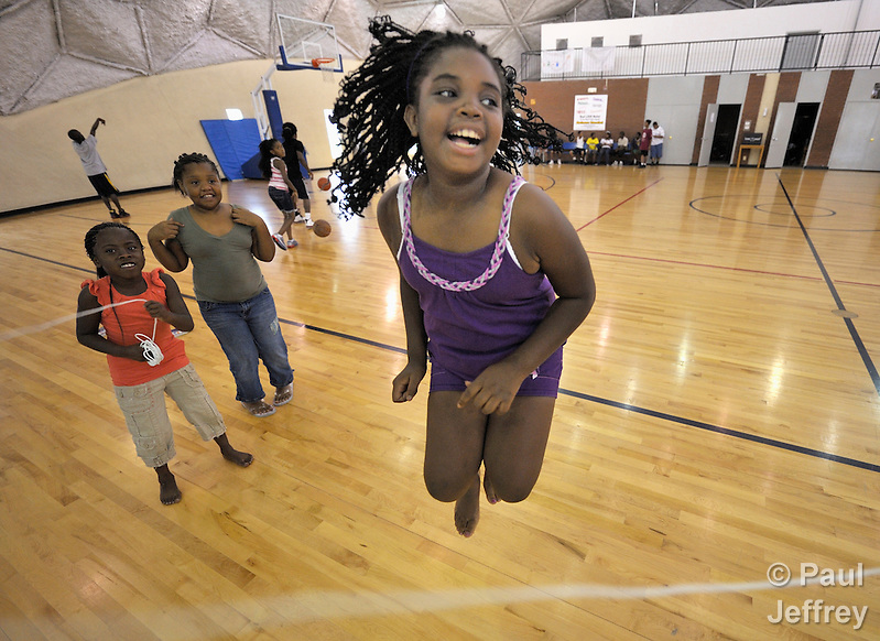 A girl skips rope in the Mary E. Brown Center, part of the Lessie Bates Neighborhood House in East St. Louis, Illinois. (Paul Jeffrey)