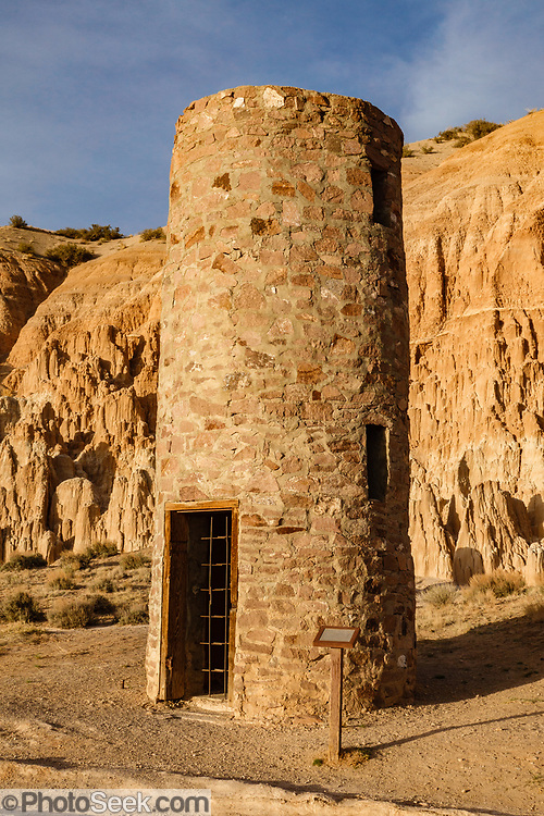 1930s CCC stone water tower at Cathedral Gorge State Park, Panaca, Nevada, USA. The stone water tower was built by the Civilian Conservation Corps (CCC) in the 1930s but is no longer in use. Million-year-old lake sediments have eroded into fantastic mud castles at Cathedral Gorge State Park. (© Tom Dempsey / PhotoSeek.com)
