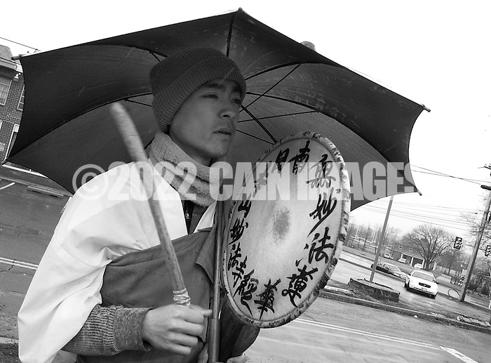 HORSHAM, PA - MARCH 29:  A buddhist monk chants and plays a drum during a protest of the Horsham Drone Command Center to protest March 29, 2014 in Horsham, Pennsylvania. (Photo by William Thomas Cain/Cain Images) (William Thomas Cain)