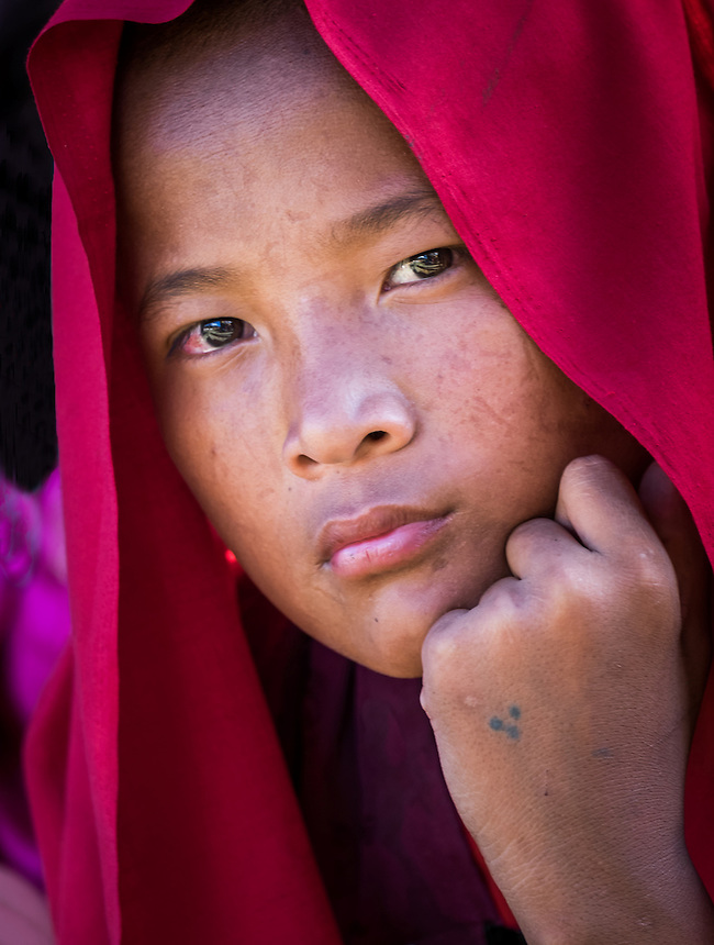 WANGDUE PHODRANG, BHUTAN - CIRCA OCTOBER 2014: Portrait of young monk looking at camera in Bhutan (Daniel Korzeniewski)