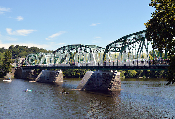 A group of concerned citizens march across the Milford Bridge to show their opposition to the proposed PennEast pipeline Saturday August 22, 2015 in Upper Black Eddy, Pennsylvania. (Photo by William Thomas Cain) (William Thomas Cain)