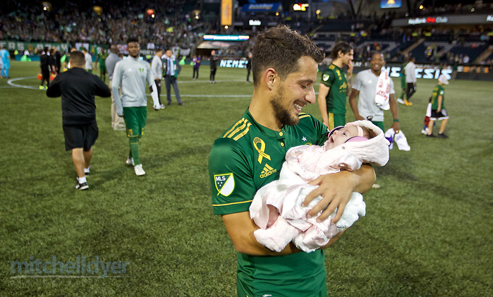 September 24, 2017; Portland, OR, USA; Portland Timbers midfielder Sebastian Blanco (10) walks on the pitch with his newborn baby daughter Fell after the match at Providence Park. Photo: Craig Mitchelldyer-Portland Timbers (Craig Mitchelldyer, Craig Mitchelldyer)