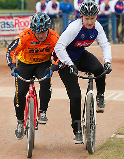12 JUL 2015 - IPSWICH, GBR - Adam Peck (right) of Ipswich Eagles attempts to hold off Chris Jewkes (left) of Wednesfield Aces as they race to the first bend during their Elite League cycle speedway fixture at Whitton Sports and Community Centre in Ipswich, Suffolk, Great Britain (PHOTO COPYRIGHT © 2015 NIGEL FARROW, ALL RIGHTS RESERVED) (NIGEL FARROW/COPYRIGHT © 2015 NIGEL FARROW : www.nigelfarrow.com)