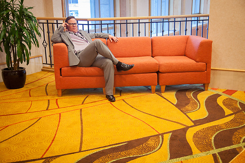 Sean makes a call during a break in his meeting at the Anchorage Marriott. (© Clark James Mishler)