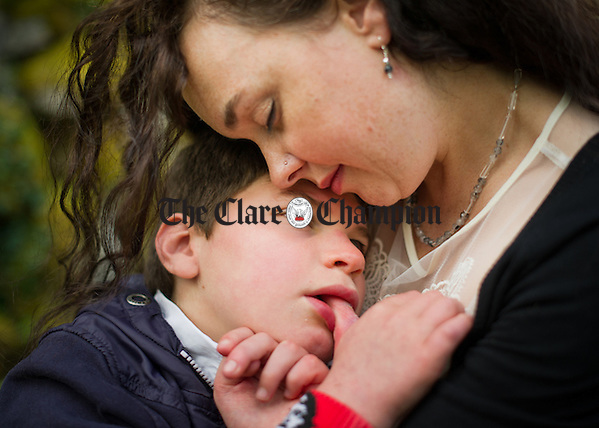 Che O Grady in the arms of  his mother Sonja Devine at the Che Kinvara fundraising event in the Burren Nature Sanctuary at Kinvara. Photograph by John Kelly. (Photograph by John Kelly/The Clare Champion)