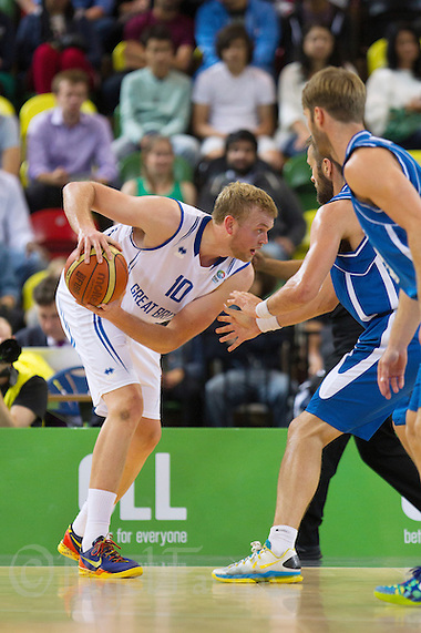 20 AUG 2014 - LONDON, GBR - Dan Clark (GBR) (left) from Great Britain looks for a way past the Iceland defence during their men's 2015 EuroBasket 3rd Qualifying Round game at the Copper Box Arena in the Queen Elizabeth Olympic Park in Stratford, London, Great Britain (PHOTO COPYRIGHT © 2014 NIGEL FARROW, ALL RIGHTS RESERVED) (NIGEL FARROW/COPYRIGHT © 2014 NIGEL FARROW : www.nigelfarrow.com)