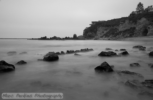 Greg and I headed out for a quick sunset shoot this day, only to find a thick marine layer completely blocking the sun.  But the cloudy sky turned out to be perfect for capturing the cove's beach and its bluffs in a more contemplative, moodier setting in black and white.  Using a long exposure smoothed out the waves and made the rocks look as though they're in a layer of mist, or visible underwater. (Marc C. Perkins)