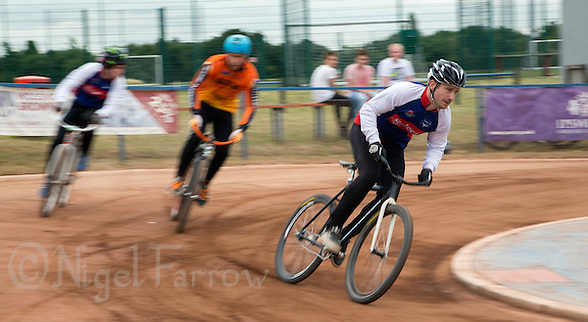 12 JUL 2015 - IPSWICH, GBR - Adam Peck (right) of Ipswich Eagles leads team mate Lewis Roberts (left) and Bobby McMillan (centre) of Wednesfield Aces during their Elite League cycle speedway fixture at Whitton Sports and Community Centre in Ipswich, Suffolk, Great Britain (PHOTO COPYRIGHT © 2015 NIGEL FARROW, ALL RIGHTS RESERVED) (NIGEL FARROW/COPYRIGHT © 2015 NIGEL FARROW : www.nigelfarrow.com)