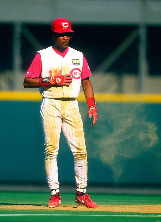 CINCINNATI:  Barry Larkin of the Cincinnati Reds looks on during an MLB game at Riverfront Stadium in Cincinnati, Ohio.  Larkin played for the Reds from 1986-2004.   (Photo by Ron Vesely)   Subject: Barry Larkin. (Ron Vesely)