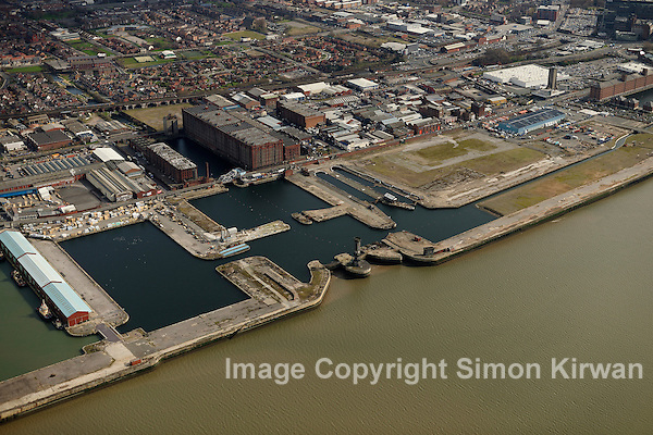 Aerial views of site of Liverpool Waters, part of Mersey Waters Enterprise Zone, to be developed by Peel Group under brand name Peel Waters in derelict docks north of Princes Dock. In the entrance to Salisbury Dock stands the hexagonal Victoria Tower, known as the Dockers' Clock, designed by Jesse Hartley, and built 1847-48 (Simon Kirwan)