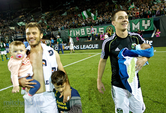 September 16, 2014; Portland, OR, USA; Portland Timbers midfielder Will Johnson (4) and forward Gaston Fernandez (10) with their children after the match during group play of the CONCACAF Champions League at Providence Park. Photo: Craig Mitchelldyer-CONCACAF (Craig Mitchelldyer)