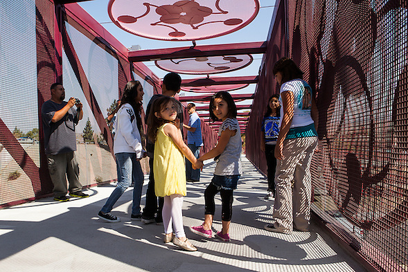 """Xander's Crossing,"" a 315-foot long prefabricated steel pedestrian bridge, was opened in San Jose on Friday, September 28, 2012. The bridge is named in honor of Alexander Arriaga, a 2-year-old boy who died after being struck by a train in 2005. (bryan farley)"