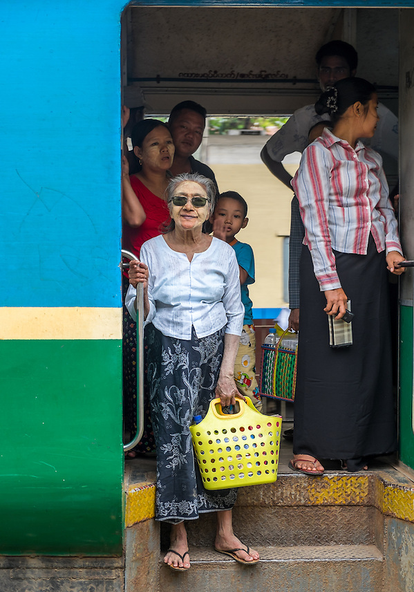 YANGON, MYANMAR - CIRCA DECEMBER 2013: Passengers in a train arriving at the Yangon Central Railway Station (Daniel Korzeniewski)