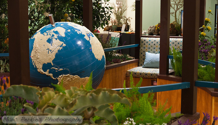 "A view of the braille world globe and one of the garden benches of Orange Coast College's Ornamental Horticulture Club's first-place winning garden installation at the 2012 South Coast Plaza Spring Garden Show in Costa Mesa, CA.  The theme for the show was ""healing gardens"", and the OCC team installed a ""garden for the visually impaired.""  The garden's centerpiece is a 1957 restored globe for the blind, with the world geography in exaggerated height to be sensed by the touch of blind people; the locations of plants in the garden was indicated in braille on the globe. (Marc C. Perkins)"