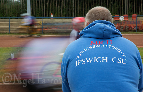14 JUN 2015 - IPSWICH, GBR - Ipswich Eagles' Maintenance Manager Bryan Harvey watches riders warm up before the team's Elite League cycle speedway fixture against Poole Comets at Whitton Sports and Community Centre in Ipswich, Suffolk, Great Britain (PHOTO COPYRIGHT © 2015 NIGEL FARROW, ALL RIGHTS RESERVED) (NIGEL FARROW/COPYRIGHT © 2015 NIGEL FARROW : www.nigelfarrow.com)