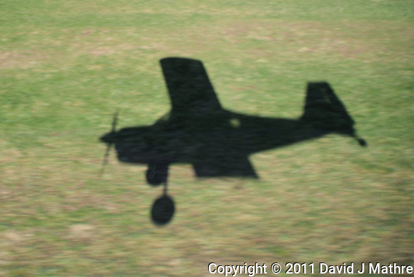 Midair Shadow while Landing in a Small Airplane at Vansant Airport. Image taken with a Nikon 1 V1 and 10-100 mm VR lens (ISO 100, 14.4 mm, f/4.8, 1/320 sec). (David J Mathre)