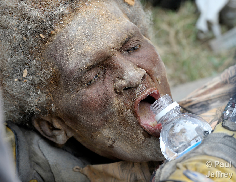 Ena Zizi gets a drink of water after being pulled alive on January 19 from the rubble of Haiti's devastating earthquake, one week after the city was reduced to ruins in a matter of seconds. The 70-year old woman was rescued from the collapsed home of the parish priest at Port-au-Prince's Roman Cathedral Cathedral of Our Lady of the Assumption by members of a Mexican search and rescue team, several of whom were in tears as they pulled the woman free from tons of rubble. She suffered from dehydration, a dislocated hip and a fractured leg, and was taken by helicopter to the U.S.S. Bataan for treatment. She told an interviewer she stayed alive by talking with God. (Paul Jeffrey)