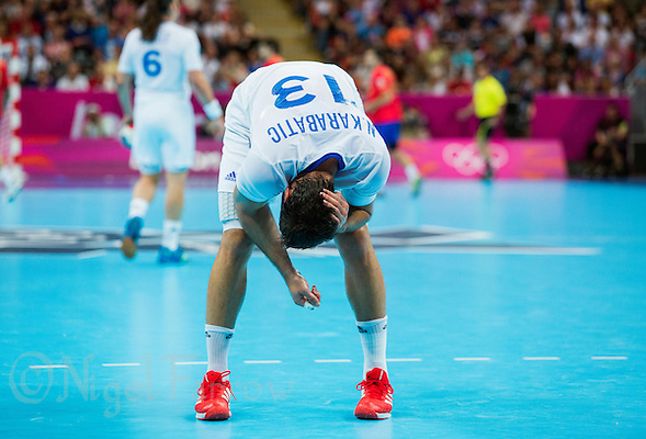 08 AUG 2012 - LONDON, GBR - Nikola Karabatic (FRA) of France holds his head after injuring it in a challenge during the men's London 2012 Olympic Games quarter final match against Spain at the Basketball Arena in the Olympic Park, in Stratford, London, Great Britain(PHOTO (C) 2012 NIGEL FARROW) (NIGEL FARROW/(C) 2012 NIGEL FARROW)
