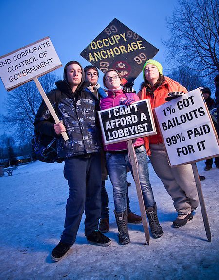 Members of Occupy Anchorage protesters: John Westlund, Joshua Leipold, Amber Fenton, and Christina Mounces on Town Square, downtown, Anchorage. (Clark James Mishler)