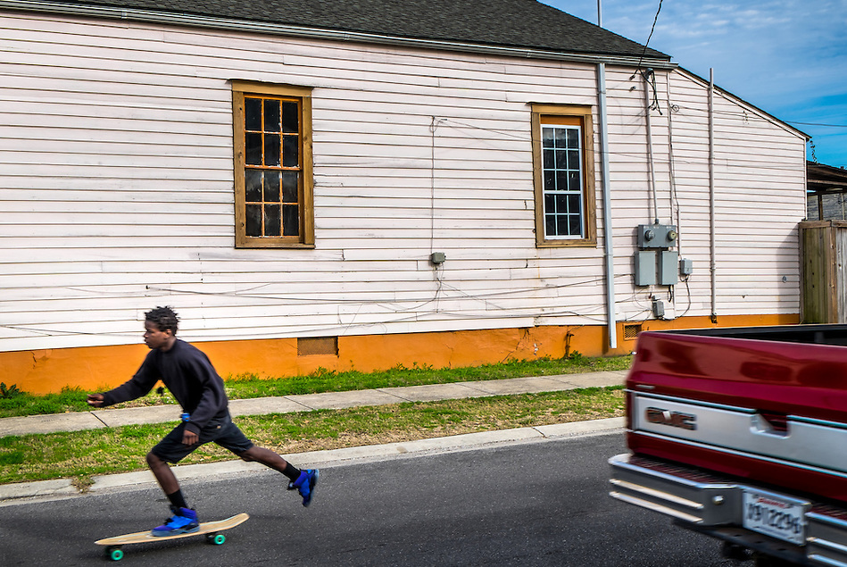 NEW ORLEANS - CIRCA FEBRUARY 2014: Young man skate boarding in the streets of McDonough, a popular community within the city of New Orleans in Louisiana. (Daniel Korzeniewski)