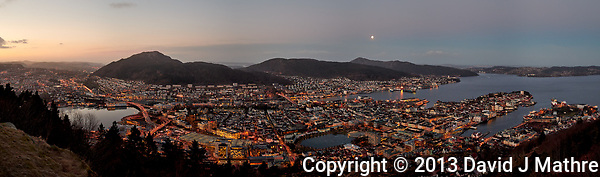 Dawn panoramic view of Bergen from Mount Fløyen. Composite of nine images taken with a Leica X2 camera (ISO 400, 24 mm, f/2.8, 1/60 sec). Raw images processed with Capture One Pro and the composite created using AutoPano Giga Pro. (David J Mathre)