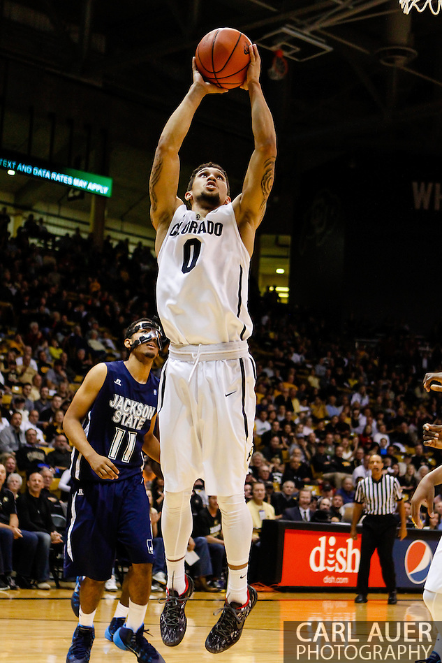 November 16th, 2013:  Colorado Buffaloes junior guard Askia Booker (0) floats up for a baseline shot in the first half of action in the NCAA Basketball game between the Jackson State Tigers and the University of Colorado Buffaloes at the Coors Events Center in Boulder, Colorado (Carl Auer/ZUMAPRESS.com)