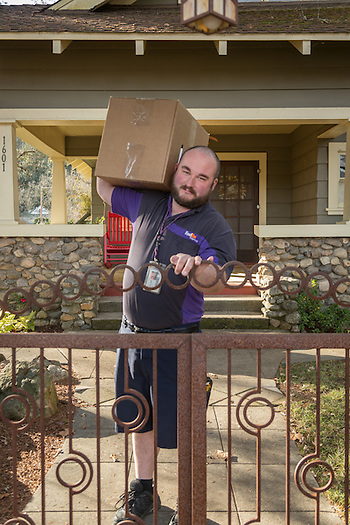 "FedEx driver Gordon Lathrop picks up a package at a house on Cedar Street in Calistoga  ""I've been working with FedEx  four years now...I love getting out every day...and a chance to wear shorts all year 'round."" (Clark James Mishler)"