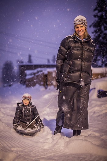 Meghan Cornelison and her five year old son Jacob during a snow storm in Anchorage's South Addition neighborhood (Clark James Mishler)