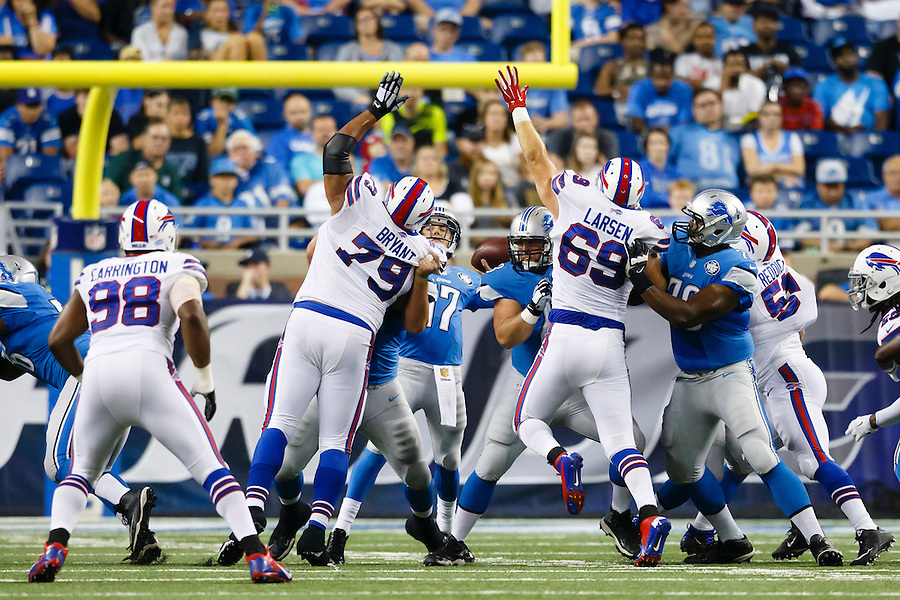 Buffalo Bills defensive tackle Red Bryant (79) and defensive end B.J. Larsen (69) pressure Detroit Lions quarterback Kellen Moore (17) during an preseason NFL football game at Ford Field in Detroit, Thursday, Sept. 3, 2015. (AP Photo/Rick Osentoski) (Rick Osentoski/AP)