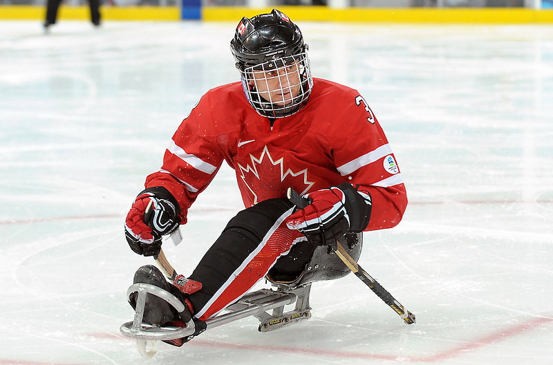 Hervé Lord (3) skates towards the play during 2010 Paralympic Games sledge hockey action at UBC Thunderbird Arena in Vancouver. Credit: CPC/HC/Matthew Manor.