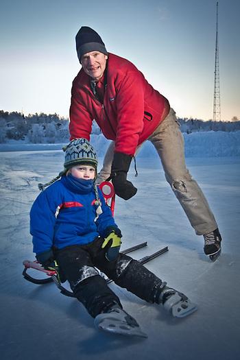 Breg Veltkamp and his son, Griffin skate at Westchester Lagoon, Anchorage (Clark James Mishler)