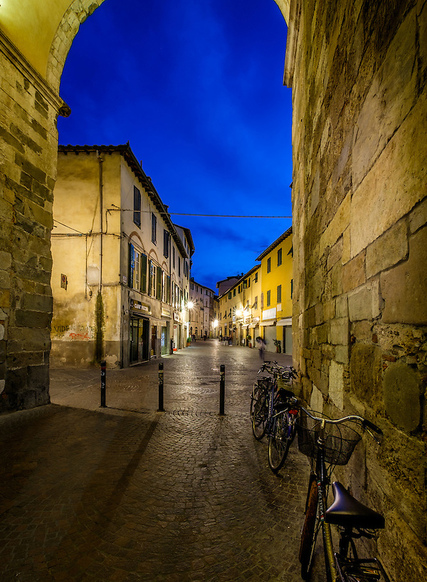 LUCCA ITALY - CIRCA MAY 2015: Street in the old walled city of Lucca at night, an historic town in Tuscany (Daniel Korzeniewski)