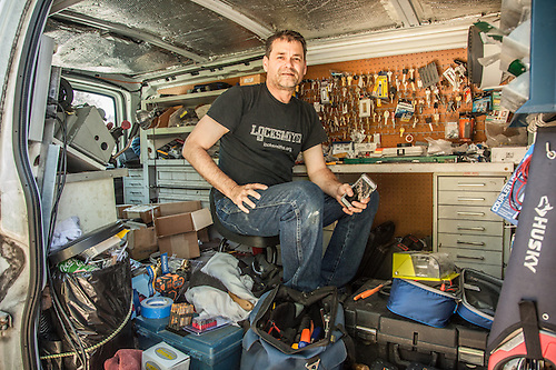 A very mobile Brian Cramer of Staint Helena Lock & Safe works from his truck while servicing a customer in Calistoga. (Clark James Mishler)