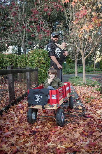 Four year old Wilder McClure is out for a walk with his father, Matt, and 3 month old sister, Luna, after a long rainly weekend in Calistoga (Clark James Mishler)