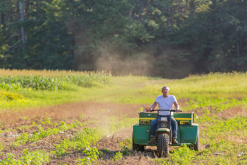 Lee Limperis working on his farm in Epping, New Hampshire. (Jerry and Marcy Monkman)