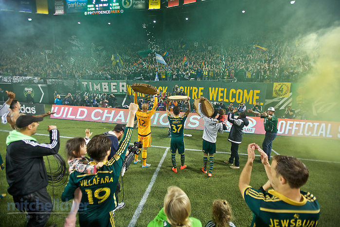 October 29, 2015; Portland, OR, USA; The Timbers hold up log slabs after the PK shootout win over Sporting KC in the first round of the MLS Cup Playoffs at Providence Park. Photo: Craig Mitchelldyer-Portland Timbers (Craig Mitchelldyer, Craig Mitchelldyer)