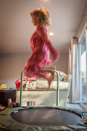 """Santa brought Mya a trampoline...we hope it will wear her out a bit."" -Jennifer Shuler (© Clark James Mishler)"