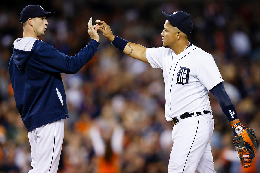 May 23, 2014; Detroit, MI, USA; Detroit Tigers starting pitcher Drew Smyly (left) and first baseman Miguel Cabrera (24) celebrate after the game against the Texas Rangers at Comerica Park. Detroit won 7-2. Mandatory Credit: Rick Osentoski-USA TODAY Sports (Rick Osentoski/Rick Osentoski-USA TODAY Sports)