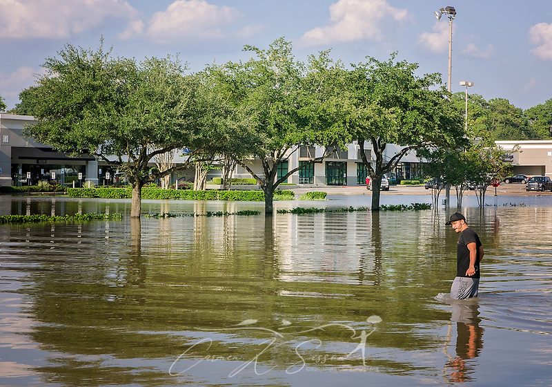A man walks through flood waters on Memorial Drive, Aug. 31, 2017, in Houston, Texas. Volunteers have streamed into Houston all week, sacrificing their time, money, and safety to help those affected by heavy flooding following Hurricane Harvey. (Photo by Carmen K. Sisson/Cloudybright) (Carmen K. Sisson/Cloudybright)