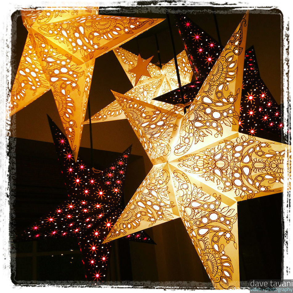 Holiday stars light up the downstairs dining room at Nomad Pizza in Philadelphia on November 26, 2012. (Dave Tavani)